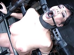 Satine Phoenix locked in an iron cage, gagged and made to cum.