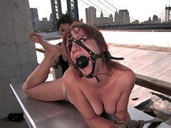 Pinky Lee is tied on a rooftop, shocked, and forced to cum