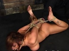 Huge boobed Christina Carter is bound and forced to cum.