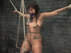 Asain cutie is tied, gagged, fucked and soaked.